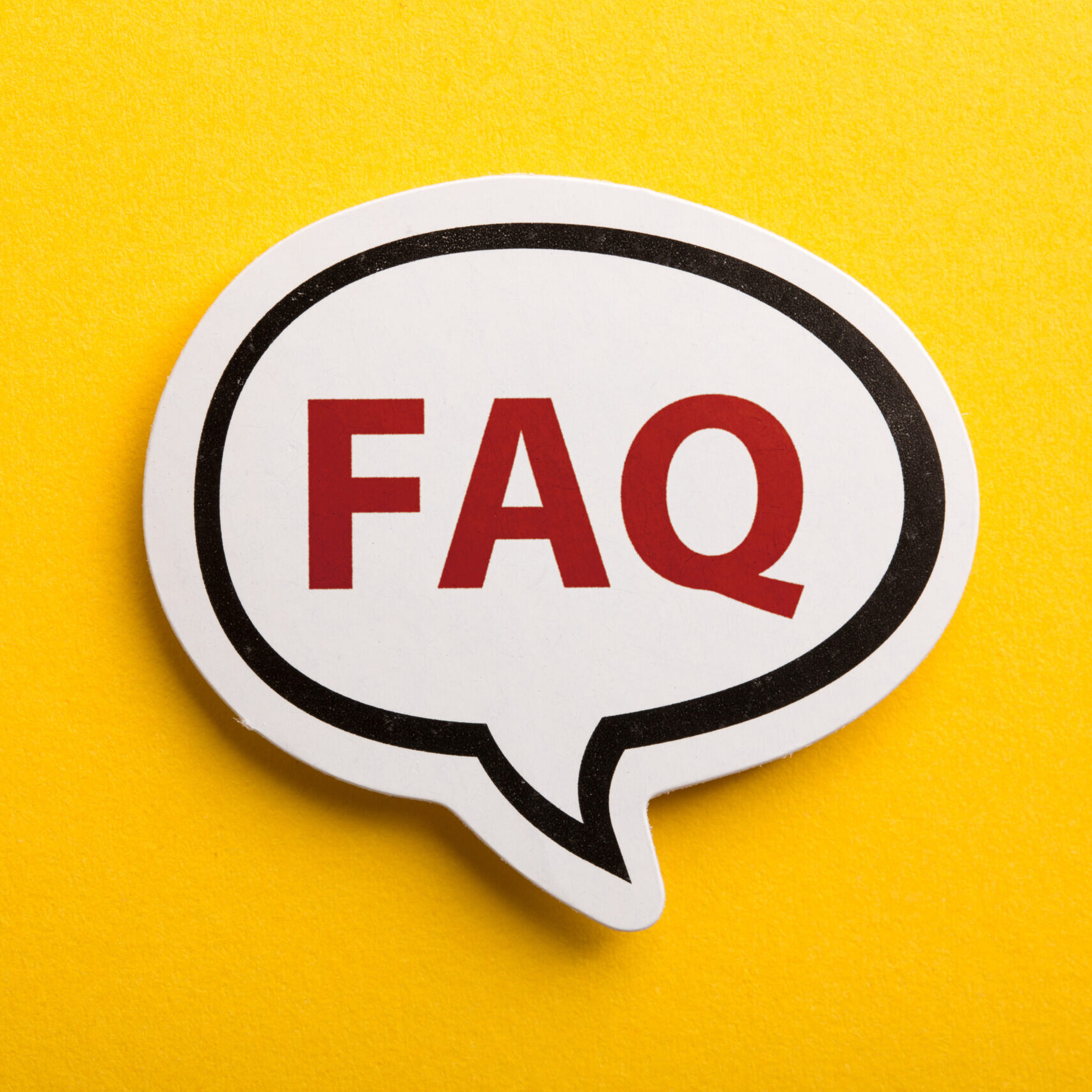 FAQ speech bubble is isolated on yellow background.